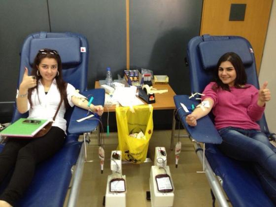 AUST Girls Donating