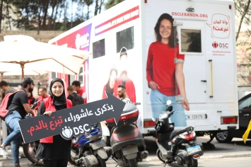 Recruiting blood donors in Haret Hreik